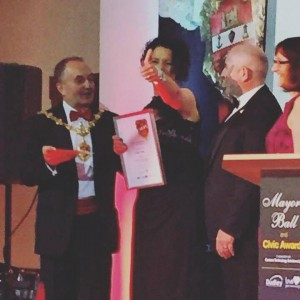 A delighted Andrea Childs collecting her award from Mayor of Dudley Seve Waltho